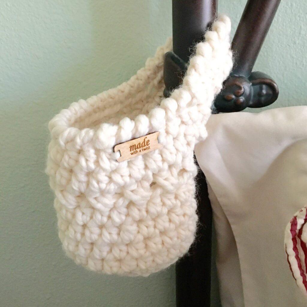 Photo of the FREE Crochet Pattern Hanging Basket on a bedside pole