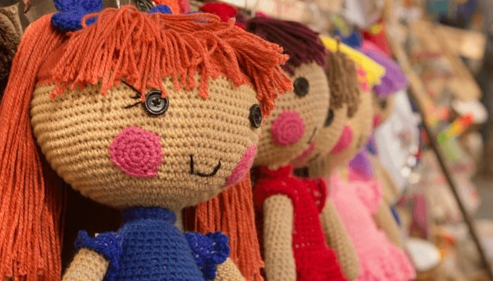 Photo of various hanging crocheted amigurumi dolls