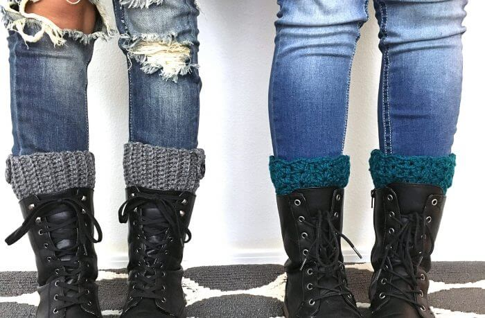 Photo of 2 persons wearing black boots and crocheted warmers