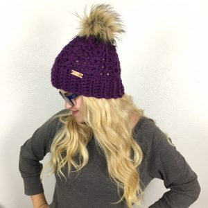 MCKENNA POMPOM BEANIE | This lovely women's winter hat is a great, everyday go-to! The ribbed brim offers the perfect stretch and warmth for even the coldest of days while the lacy shell pattern makes it a beautiful accessory to your casual cold-weather outfits. Top it with a faux fur pom, a matching pom or leave plain - whatever your choice, this hat is stunning. A quick and easy crochet, you can complete this hat in about an hour!