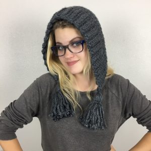 "CHELSEA EARFLAP HAT CROCHET PATTERN | Mysterious and Modern, Cute and Couture, whatever your fashion ideals, this hat is perfect for you! It's loose fit prevents hat-head and the tassel embellisment scream, ""I've got style!"" This pattern whips up in less than an hour and is perfect for both beginner and expert crocheter alike."