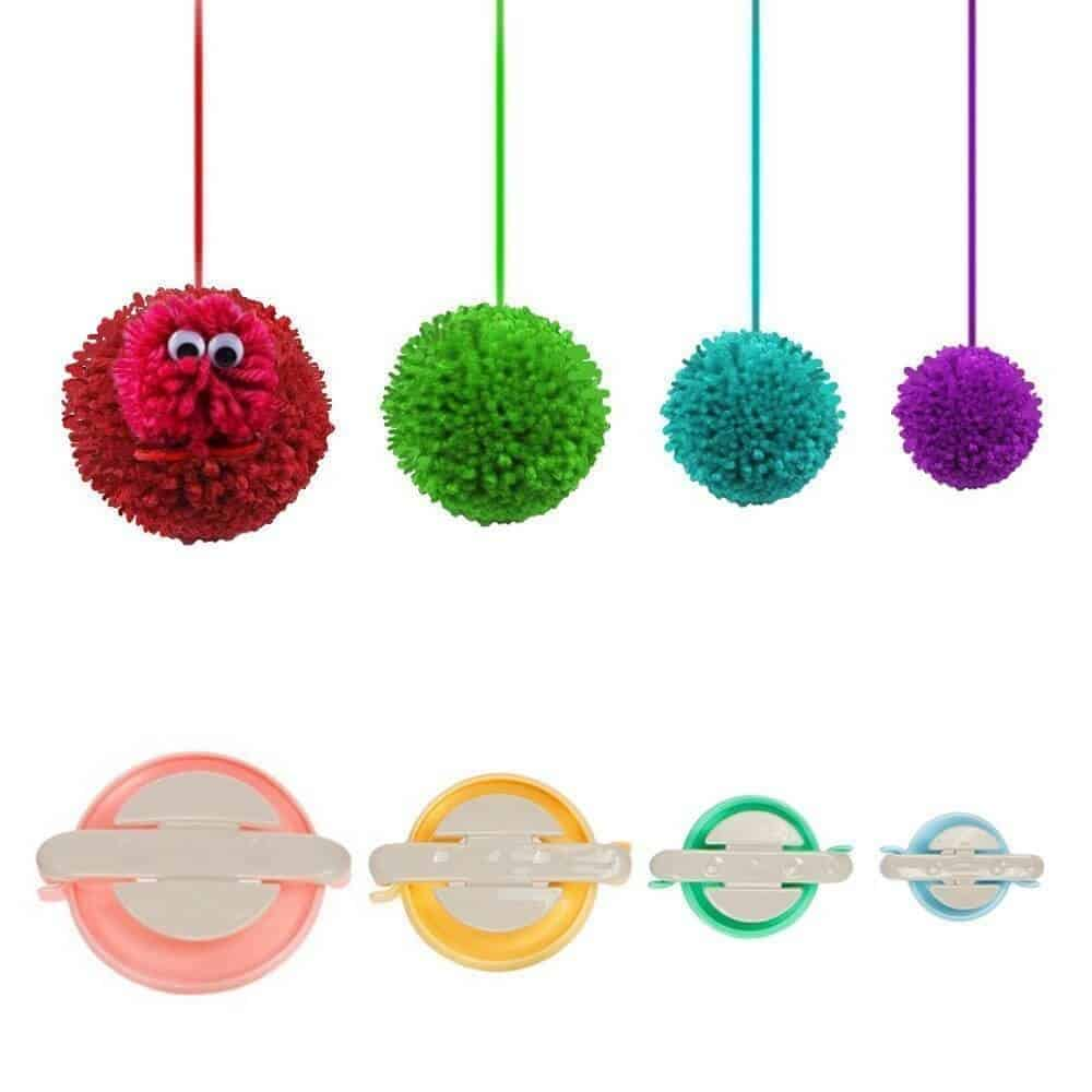 Photo of 4 Pompom Maker from Knewmart in red, green, aqua blue, and purple color