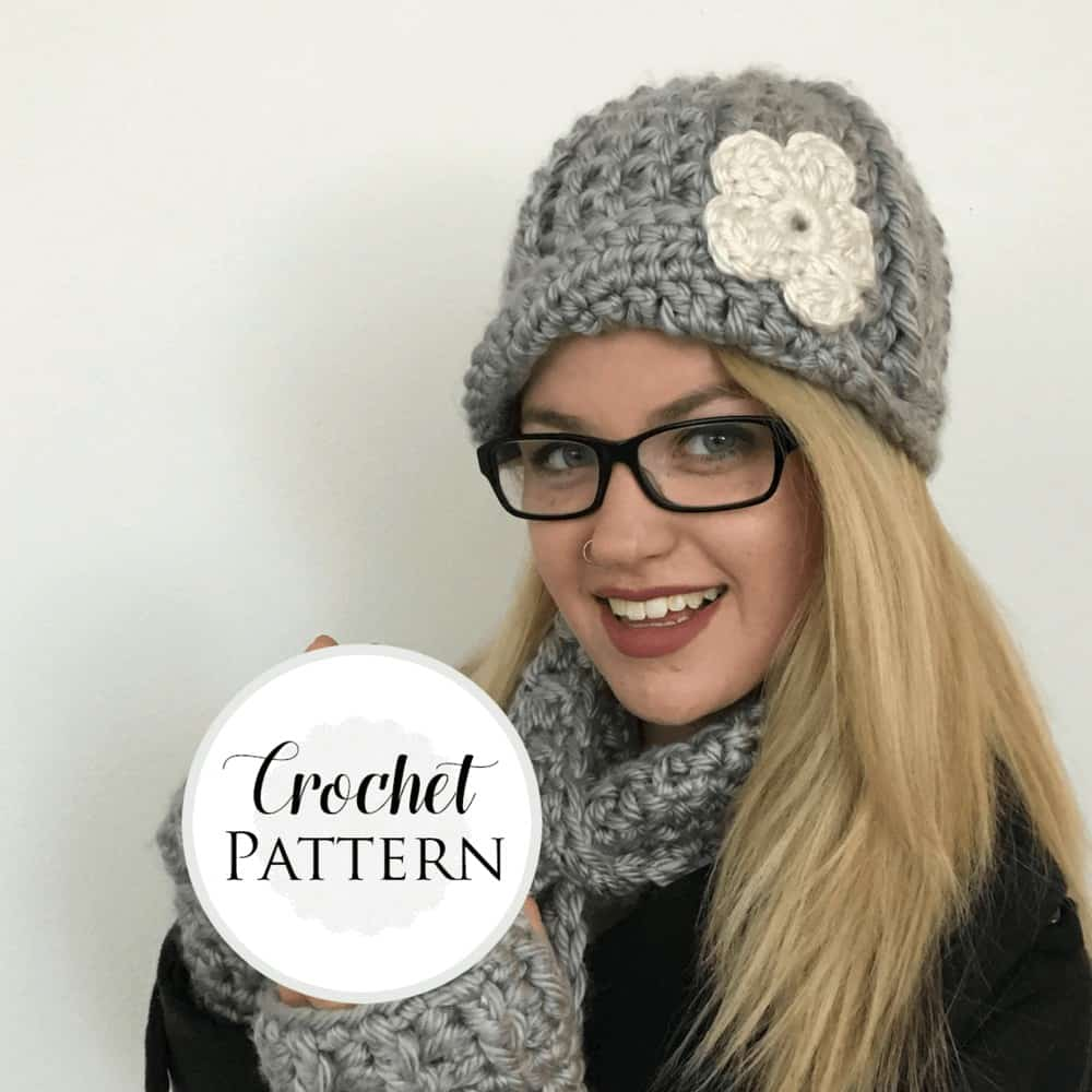 A photo of a woman wearing crocheted beanie and scarf, crochet pattern from Made with a Twist