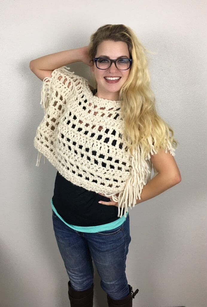 Woman wearing glasses and Santa Fe Boho Crop Top over a black shirt