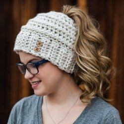 Photo of a woman wearing the crocheted Beehive Messy Bun Hat