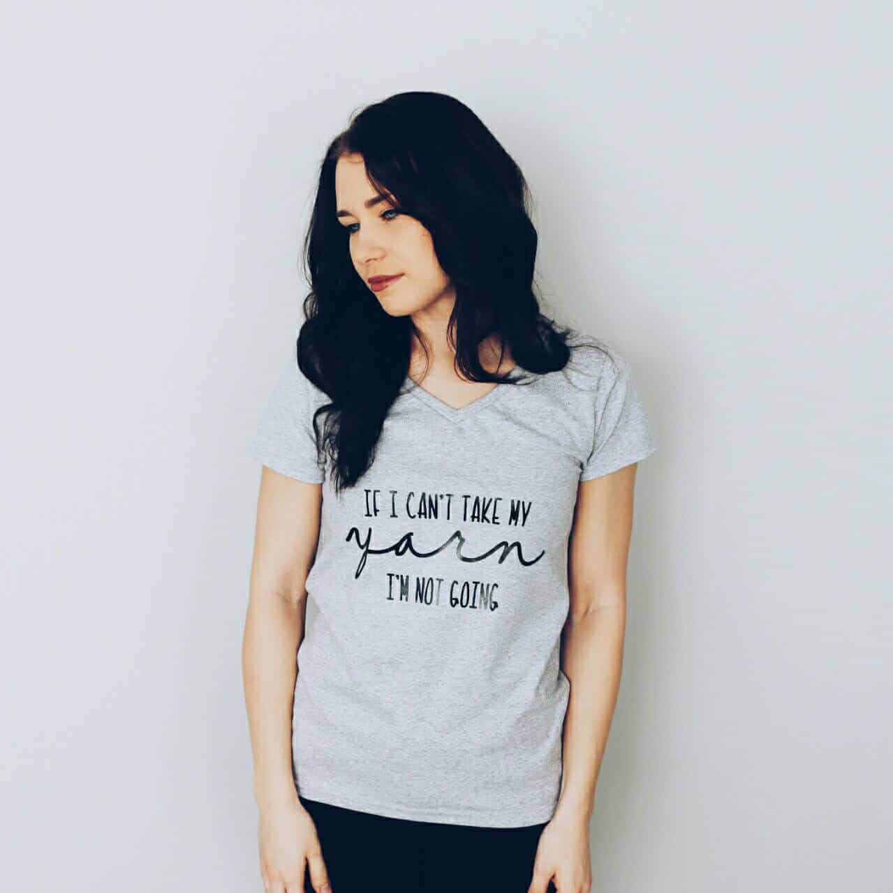"""Photo of a woman wearing a gray shirt with """"If I Can't Take My Yarn"""" on it"""