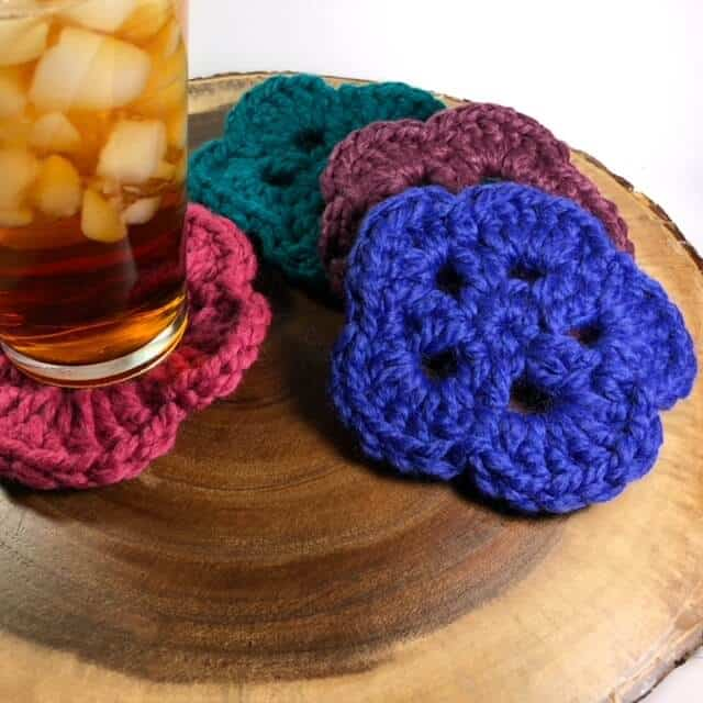 Photo of 4 crocheted Coasters with a glass of iced sweet tea