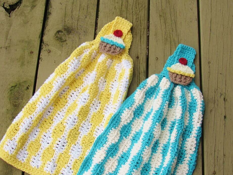 Photo of 2 Crochet Pot Holders and Towels Pattern laid down on a wooden table