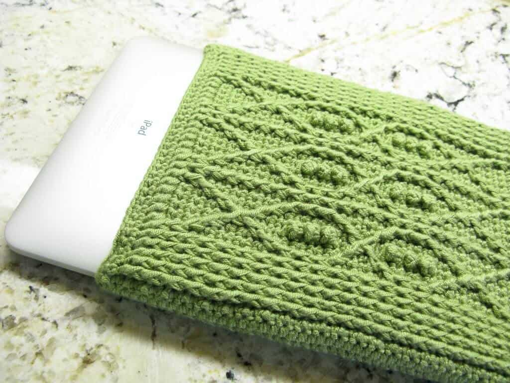 Photo of an iPad with a crocheted cover with fish details
