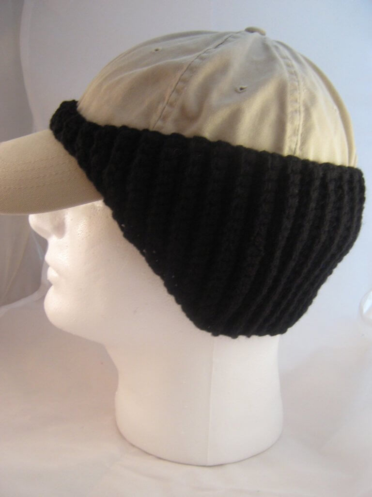 Photo of a cap on a mannequin head with a crocheted baseball cap ear warmer