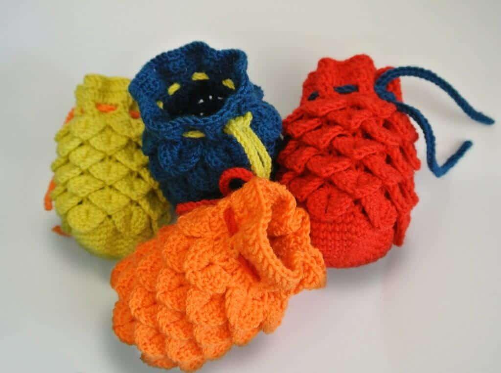 Image of four crocheted dragon egg dice bag