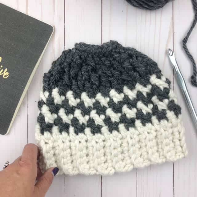 Photo of crocheted Kaydence Ponytail Hat on a table