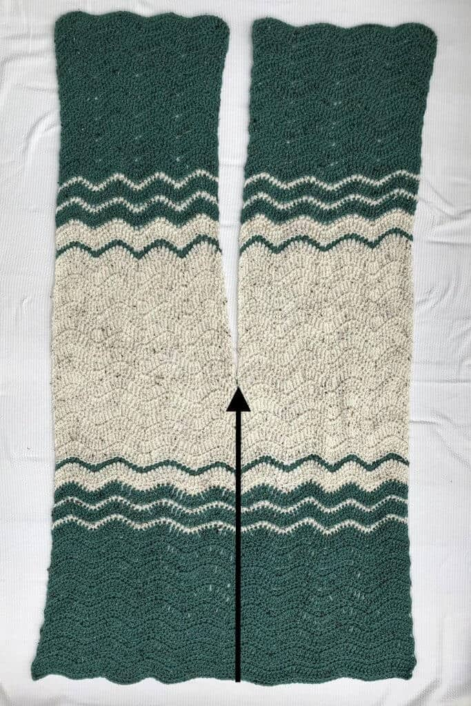 Photo of the crocheted Ripple Blanket Wrap stretched in a flat surface