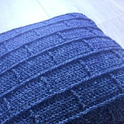 Photo of the crocheted blue Building Blocks Pillow