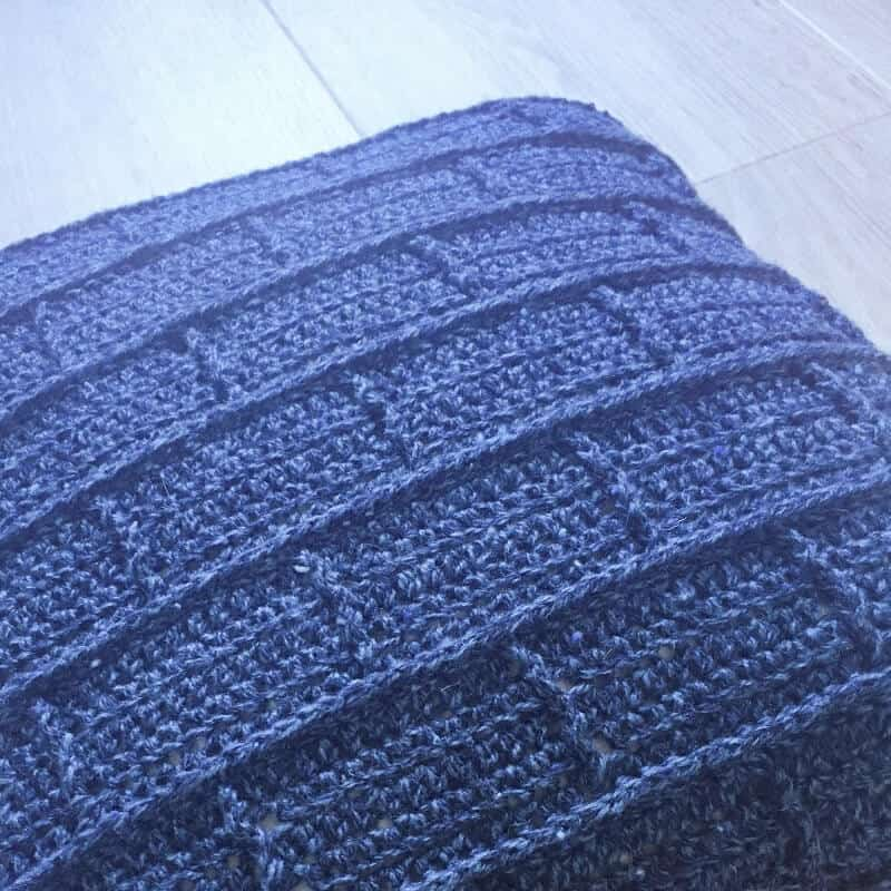 Closer look at the details of this crocheted blue throw pillow
