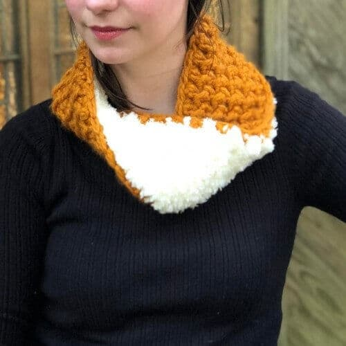 Photo of a woman enjoying her crocheted Reversible Cozy Cowl