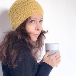 Photo of guest designer Dora White holding a cup, the woman behind Crafted by Dora