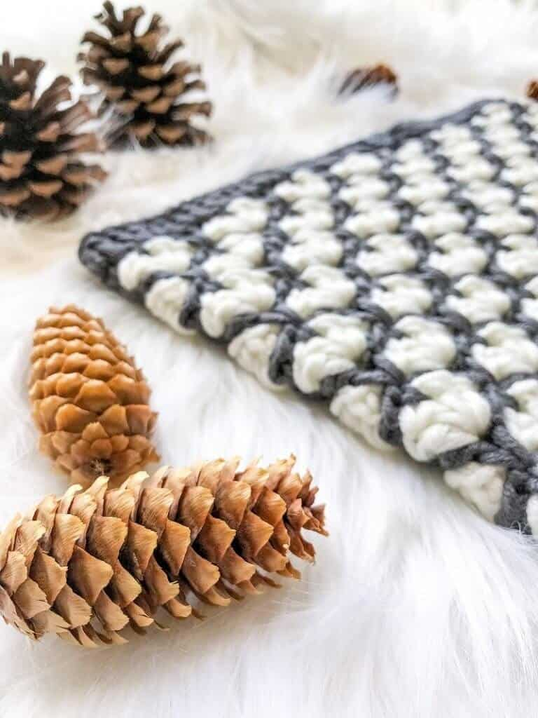 Photo of the chunky winter cowl with pine cones