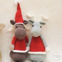 Photo of crocheted Einar the Elk wearing Christmas outfits
