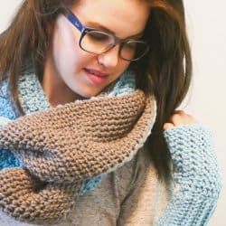 Photo of a woman wearing the glasses and crocheted Reversible Infinity Super Scarf
