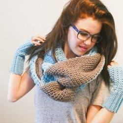 A woman wearing the Reversible Infinity Super Scarf with a crocheted fingerless gloves