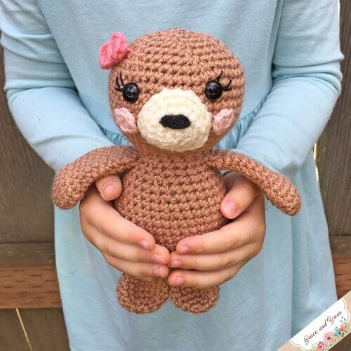 Photo of the FREE Amigurumi Seal Pup Crochet Pattern with a flower on its head