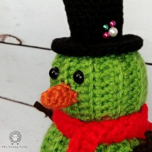 Closer look at Stanley the Cactus Snowman's face and top hat details