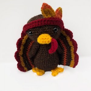 Photo of the crocheted Thanksgiving Turkey wearing a headband