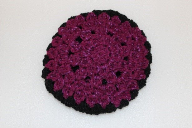 Photo of the crown of the colorful crochet beanie with while background