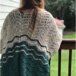 Photo of a woman wearing the crocheted Ripple Blanket Wrap