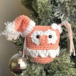 Photo of crocheted Owletta on the Shelf on a Christmas tree as an ornament