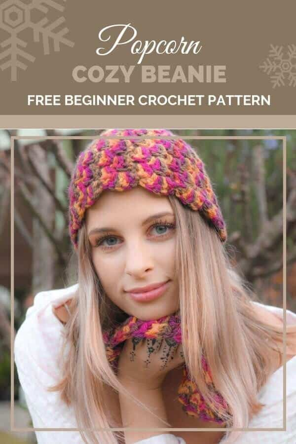 Pinterest graphic for Popcorn Cozy Beanie FREE Beginner Crochet Pattern with a photo of a woman wearing a colorful hat with a scarf