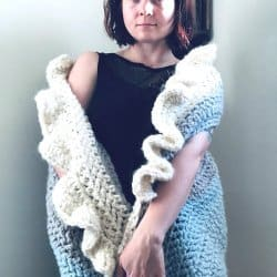 Photo of a woman wearing the crocheted Sleigh Ride Wrap
