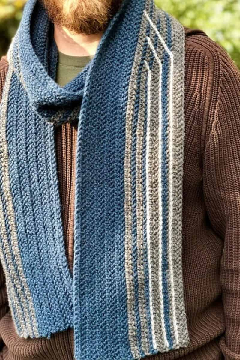 Close look on the unique Sleigh Ride geometric men's scarf worn by a guy