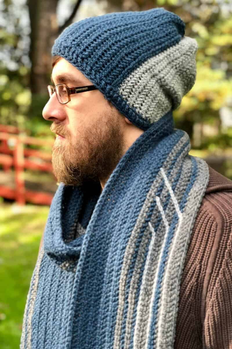 Photo of a guy wearing the Sleigh Ride Men's Scarf FREE Crochet Pattern with hat and glasses