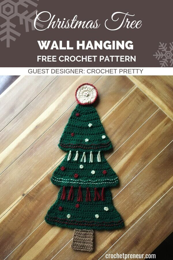 Add some rustic interest to your holiday decor with this Evergreen Christmas Tree Wall Hanging Crochet Pattern. Tassels and garland really make this motif the star of your holiday decor. Get the pattern for free! #christmastreewallhanging #wallhangingcrochetpattern #freecrochetpattern #crochetforchristmas