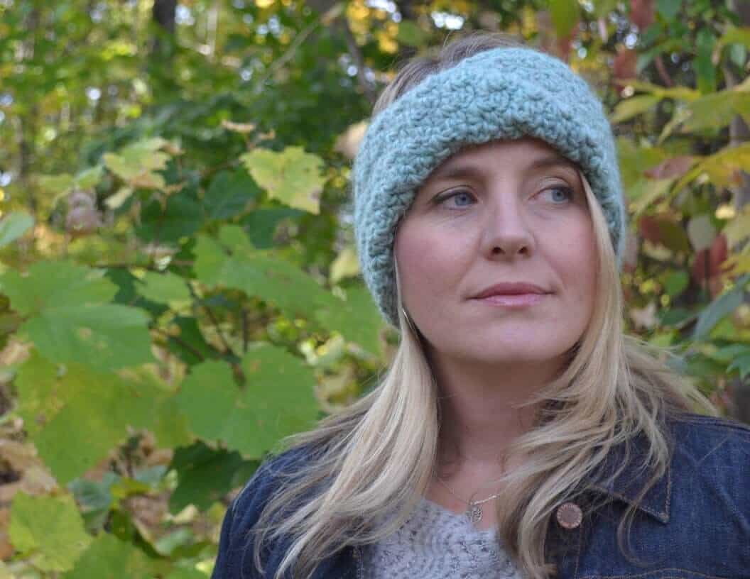Photo of a woman wearing the soft crocheted Brianna Turban Headband