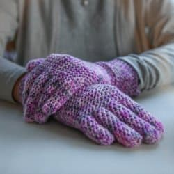 Photo of a person wearing the Easy Fit Lite Gloves with fingers FREE Crochet Pattern