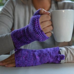 Photo of a person wearing the fingerless version of the Easy Fit Lite Gloves while holding a mug