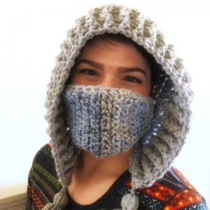 A woman wearing the crocheted Snow Day Hood with mask