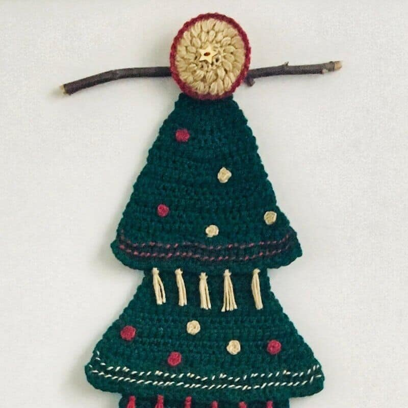 Tutorial photo for adding a branch on the Christmas tree home decor for a rustic touch
