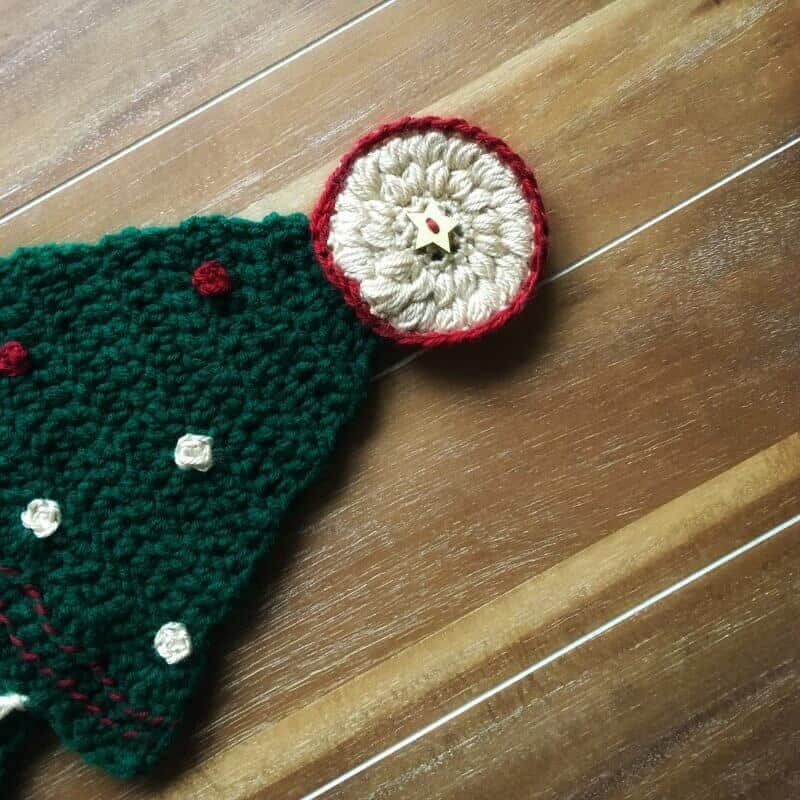 Tutorial photo for adding the top decoration to the Christmas tree wall hanging FREE crochet pattern
