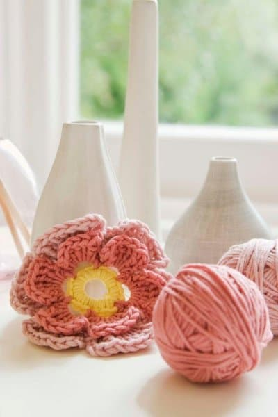 may income report featured image, some white vases and a pink crocheted flower